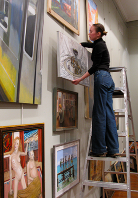 Katerina is helping to hang an oil show at ASL